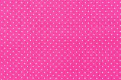 与白色小点的瓦片桃红色逗人喜爱的样式 免版税库存照片