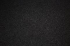 与白色小螺纹的黑纸板 纹理 免版税图库摄影