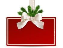 与白色弓的红色纸圣诞卡。 皇族释放例证