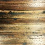 与白色油漆的布朗脏的困厄的木地板纹理 图库摄影