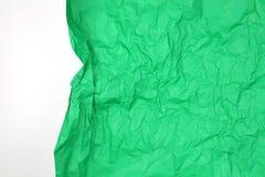与白色空间的被弄皱的绿皮书 免版税库存照片