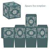 与白色花卉元素的绿色箱子模板 免版税库存照片