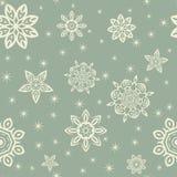 与白色雪花的减速火箭的圣诞节样式在蓝色背景 免版税库存照片