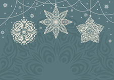 与白色雪花的减速火箭的圣诞节背景在蓝色背景 免版税库存照片