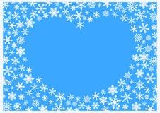 与白色雪花的圣诞节背景在蓝色背景 库存图片