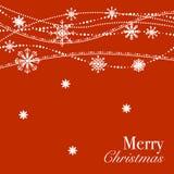 与白色雪花的红色圣诞节背景设计 库存照片