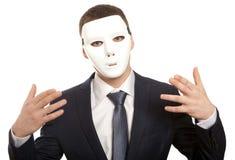与白色面具的商人 免版税图库摄影