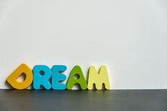 与白色background1的五颜六色的木词梦想 图库摄影