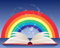 与白页和闪闪发光的彩虹不可思议的书在蓝色背景 库存照片