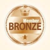 与皇家冠和一个星的古铜色成员徽章 库存照片
