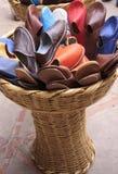 与皮革拖鞋的篮子 免版税库存图片