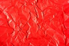 与皱痕摘要的红色纸 免版税库存照片