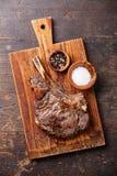 与盐和胡椒的Ribeye牛排 库存照片