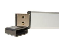 与盖子盖帽的特写镜头开放USB闪光驱动 免版税库存照片