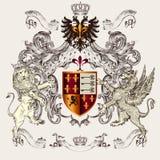 与盾、冠、新来的人和狮子的美好的纹章学设计 免版税库存照片