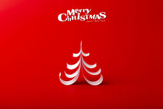 与真实的纸圣诞树的圣诞节明信片 图库摄影
