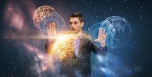 与真正行星和空间的商人 免版税库存照片