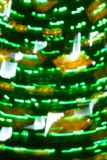 与眨眼睛绿灯的圣诞节假日被弄脏的背景 库存图片