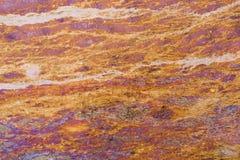 与石纹理的减速火箭的抽象橙色背景 免版税库存图片