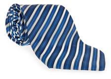 与石榴石蓝色和白色五颜六色的装饰小条的滚动的领带  库存图片