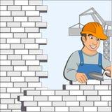与砖墙的建造者 免版税库存图片