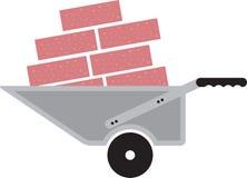 与砖的独轮车 免版税库存图片