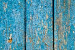 与破旧的蓝色油漆的老木纹理 库存照片