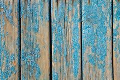 与破旧的蓝色油漆的老木纹理 图库摄影