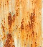 与破裂的油漆橙色白色棕色概略的纹理长方形形状的生锈的金属背景 库存照片