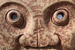 与硬币的雕象在眼睛 图库摄影