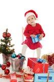 与礼品的圣诞老人辅助工 图库摄影