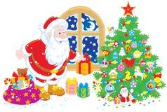 与礼品的圣诞老人 免版税库存照片