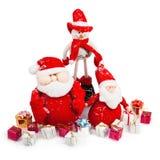 与礼品的圣诞节圣诞老人和雪人 免版税库存图片