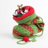 与礼品的圣诞节袋子 免版税库存照片