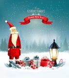 与礼物和圣诞老人的圣诞节背景 免版税库存照片