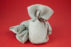 与礼物的布料袋子 免版税图库摄影