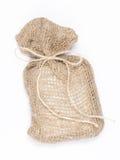 与礼物的米黄帆布袋子 免版税图库摄影