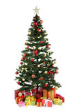 与礼物的装饰的圣诞树在白色 图库摄影