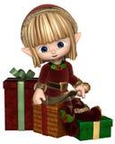 与礼物的逗人喜爱的印度桃花心木圣诞节矮子 免版税图库摄影