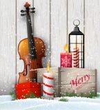与礼物盒和小提琴的圣诞节静物画 皇族释放例证