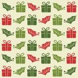 与礼物盒和槲寄生的圣诞节无缝的样式 向量例证