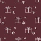 与礼物盒和雪花的无缝的样式 免版税库存照片