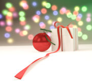 与礼物盒的新年球 图库摄影