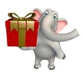 与礼物盒的逗人喜爱的大象漫画人物 图库摄影