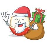 与礼物红毛丹吉祥人动画片样式的圣诞老人 皇族释放例证