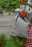 与礼物袋子的圣诞节装饰 库存照片