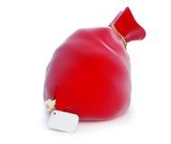 与礼物钥匙的圣诞老人的红色袋子 免版税库存照片