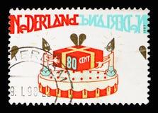 与礼物,问候的生日蛋糕盖印serie,大约1997年 图库摄影