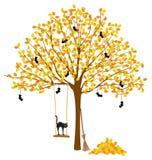 与秋叶和万圣夜装饰的树 免版税库存照片
