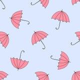 与秋天和五颜六色的遮阳伞的无缝的背景 库存照片